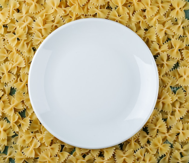 Empty plate on farfalle pasta