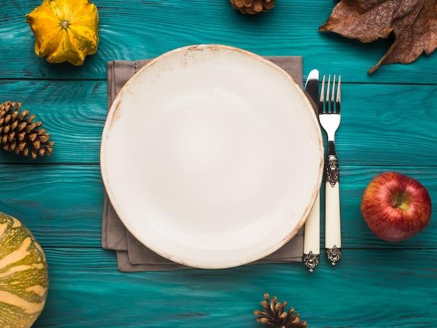 Empty plate on green autumn