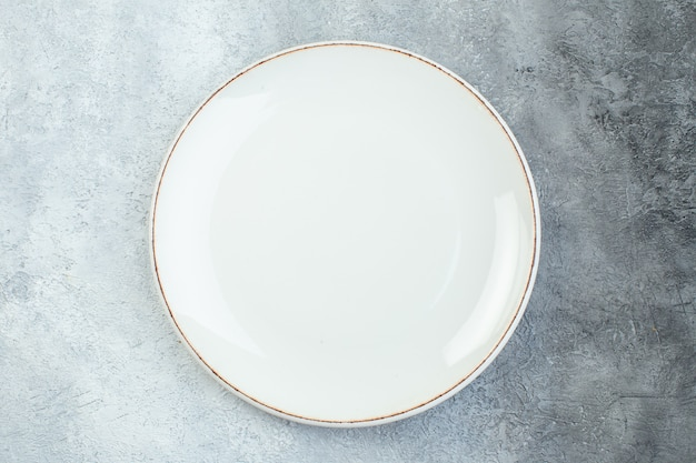 Empty plate on half dark light gray surface with distressed coarse-grained gradient surface