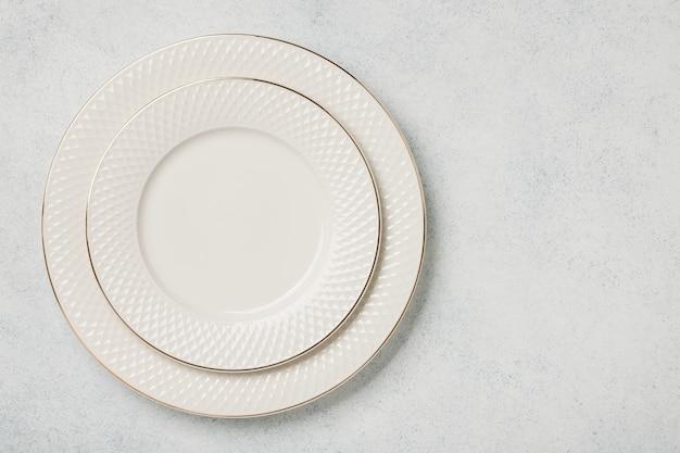 Empty plate set on stone background