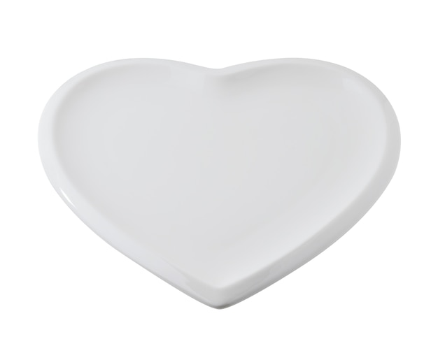 Empty plate in the shape of a heart on a white background