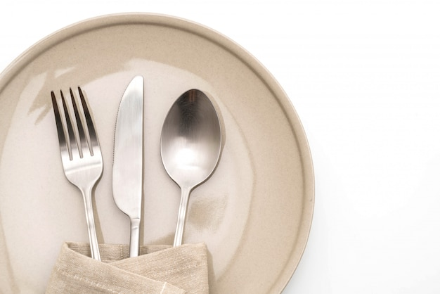 Empty plate, spoon, fork and knife