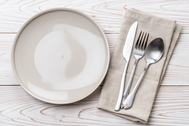 Empty plate spoon fork and knife