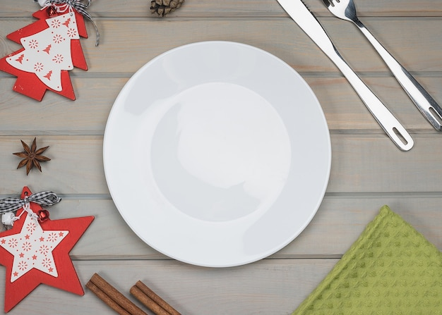 Empty plate with christmas and new year decoration for the holiday menu.