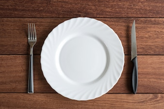 Empty plate with knife and fork, Top view