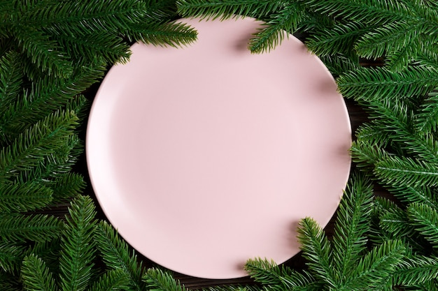 Empty plate with tree branches