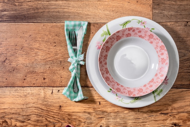 Empty plate on wooden table top view