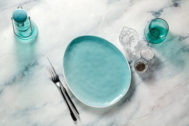 Empty plates on the marble table.
