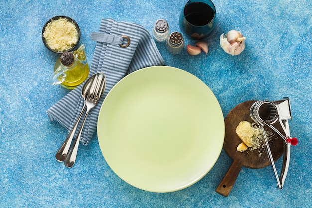 Empty plates on the table set for lunch or dinner.