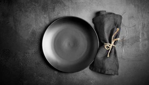 Empty porcelain plate on dark background, black, grey, culinary background, tableware, menu, cook,rustic, dish, dark, top view