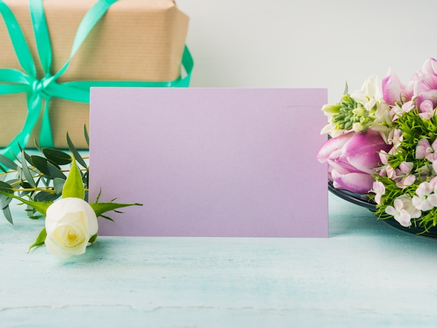 Empty purple card flowers tulips roses spring pastel color background with copyspace.