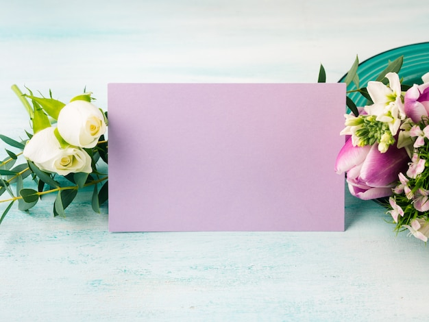 Empty purple card flowers tulips roses spring pastel color . easter holiday, wedding birthday invitation