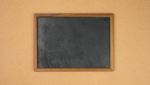Empty rectangular brown wooden frame on a brown background, copy space