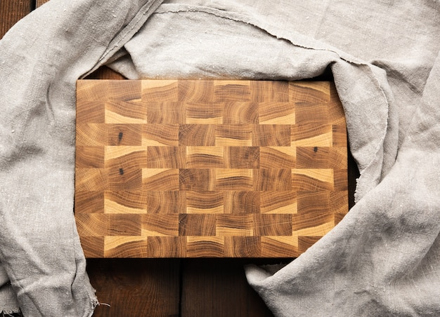 Empty rectangular wooden cutting kitchen board on table, top view