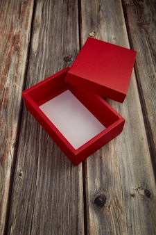 Empty red box on bright brown wood