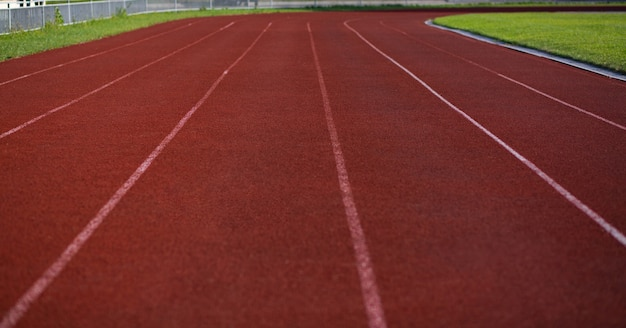 Empty red running track with markup outdoor Premium Photo