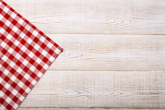 Empty red table cloth on wooden table top view mockup.