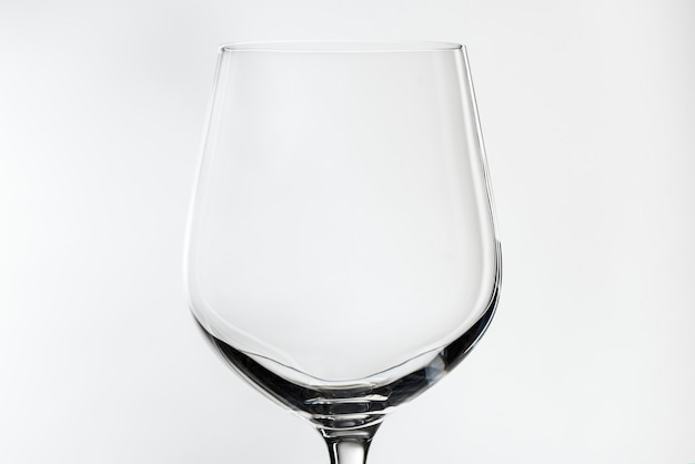 Empty red wine glass isolated