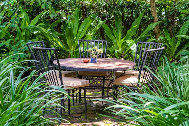 Empty restaurant terrace in tropical garden with tables and chairs. tanzania, east africa