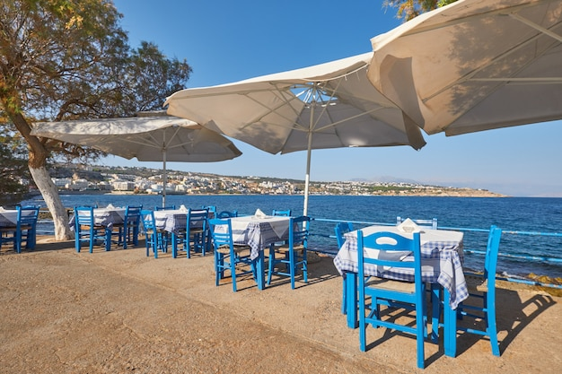 Empty restaurant with parasols at the seaside