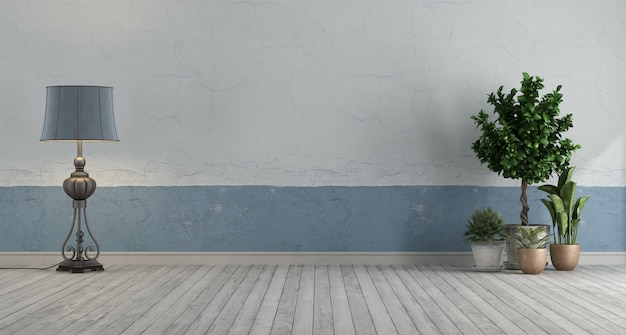 파란색과 흰색 오래 된 벽을 가진 빈 복고풍 방