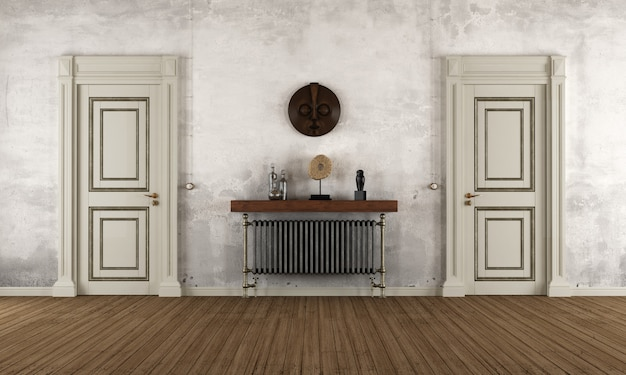 Empty retro room with two old doors and radiator