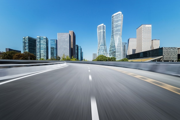 Empty road floor surface with modern city landmark buildings
