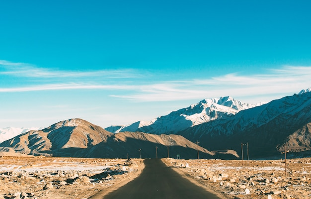 The empty road leading to himalayan range in the winter season