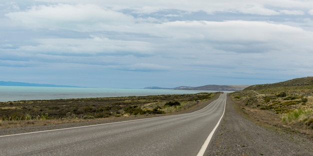 Empty road passing through coast, santa cruz province, patagonia, argentina