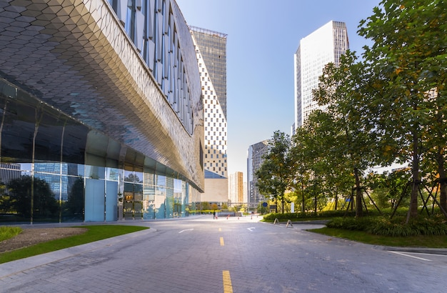 Empty road with modern city landmark buildings of hangzhou bund skyline, zhejiang, china