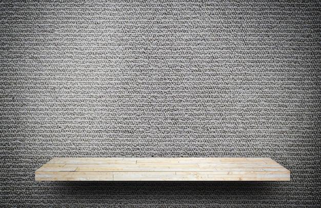 Empty rock stone shelf on gray carpet background