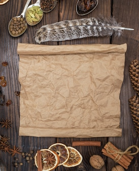 Empty rolled brown paper sheet on a wooden background