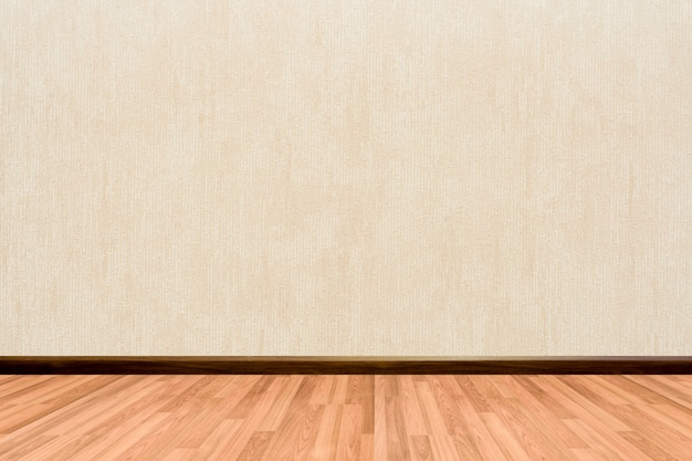 Empty room background with wooden floor cream or beige wallpaper.