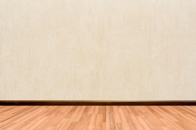 나무 바닥 크림 또는 베이지 색 벽지와 빈 방 배경.