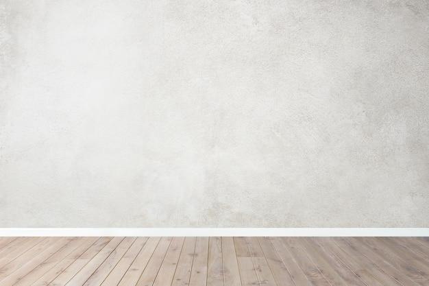 Stanza vuota con pareti grigie e pavimento in legno