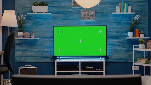 Empty room with green screen on television in living room
