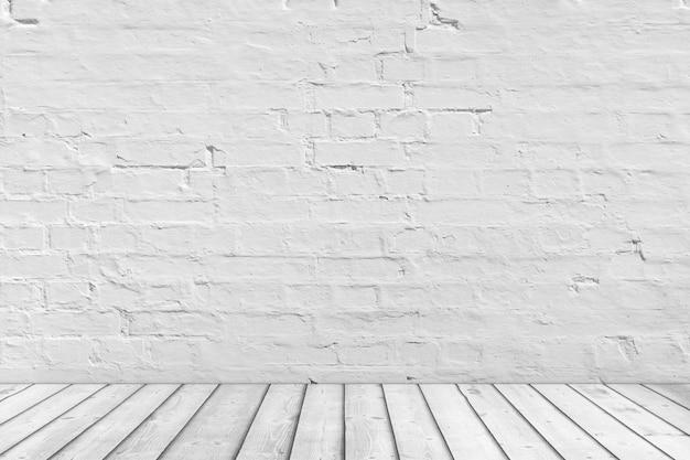白いレンガのグランジの壁と板の木製の床の極端なクローズアップと空の部屋。 3dレンダリング