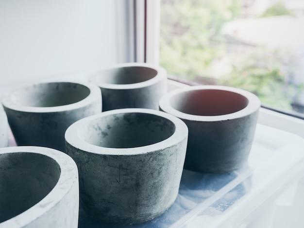 Empty round concrete pots