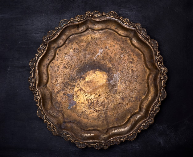 Empty round copper plate with monograms