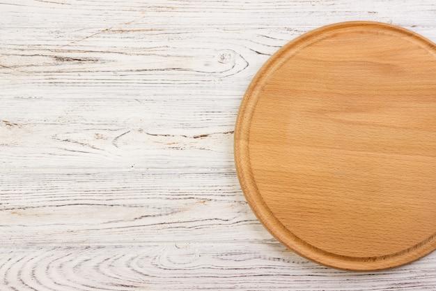 Empty round cutting board background