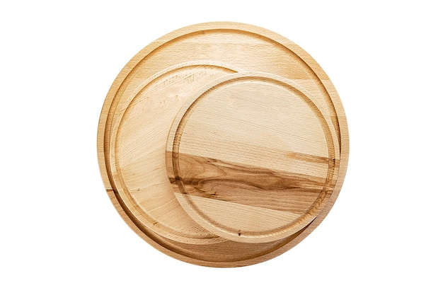 Empty round cutting board on white background isolated.