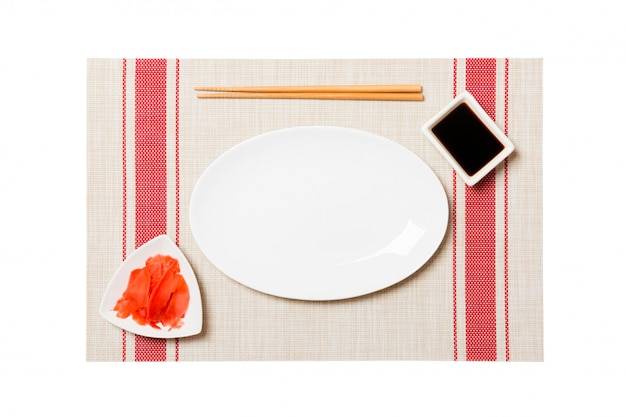 Empty round gray plate with chopsticks