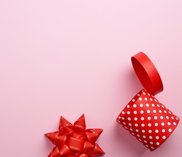 Empty round red cardboard box in white polka dots