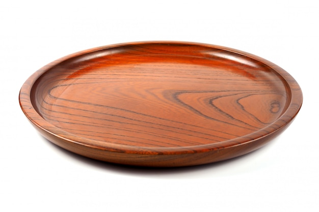 Empty round wood plate, brown wooden dish