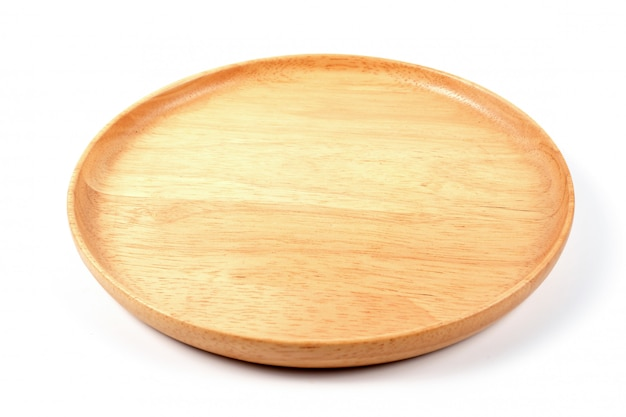 Empty round wood plate on white