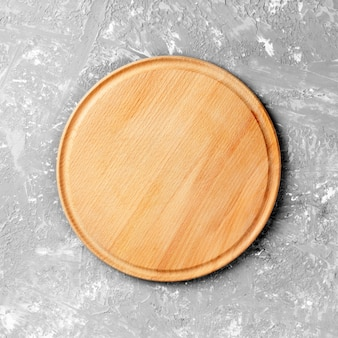 Empty round wooden dish on table