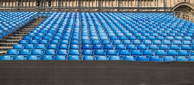 Empty rows of chairs, seats in the concert hall, in the sports hall.