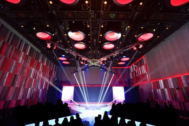Empty runway fashion show x cross type catwalk with moving beam lighting