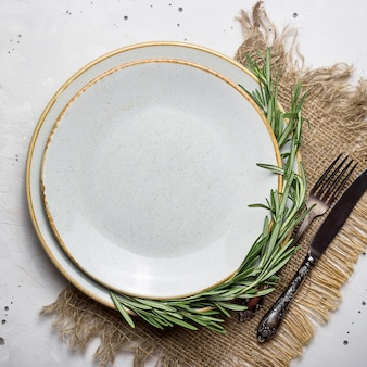 Empty rustic plate with burlap napkin and cutlery