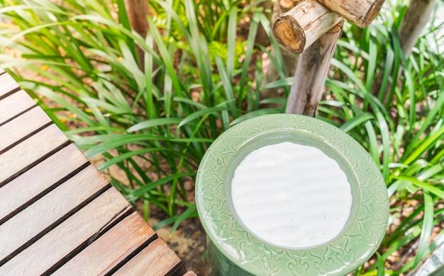 Empty sand ashtray outdoor .
